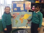 Lily and Binto pointing out where bears live in the world!
