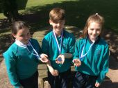 Aimee,Dara and Grace with their individual swimming medals