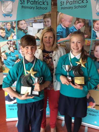 Dara Hughes and Gabrielle Vaiksnoraite receive top Numeracy awards from Mrs Perry