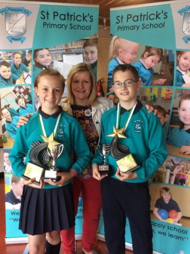 Zoe O Hare and Ben Scowcroft receive top Literacy awards from Mrs Perry