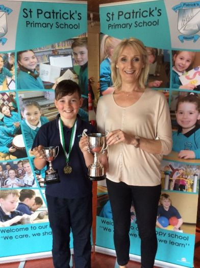 Vincent Mc Anerney received the Music and Arts award from Mrs Bennett