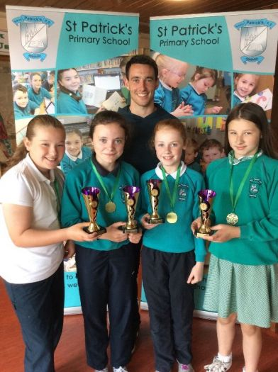 Outstanding Girls' Gaelic football awards were presented to Caolaigh Marie Haughey, Molly Largy, Aine Whyte and Aoife Mc Geown from Mr Marc Cullen