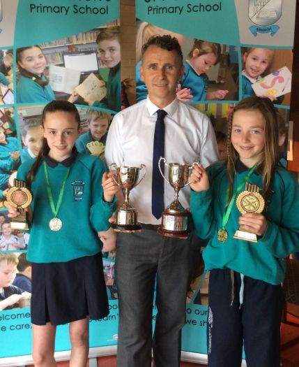 Holly Mc Keever was awarded the Athlete of the year award and Grace Guy was presented with the Swimmer of the year award from Mr O Hare